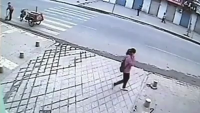 Girl In China Falls into the Manhole