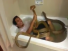 Boy Taking Bath With Snakes