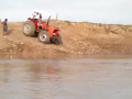 Tractor Crosses Over The River