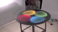 Vibrating Colored Sand On Metal Table
