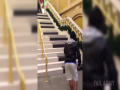 Man Fails On Piano Stairs