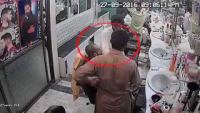 Mobile Snatching Footage In Hair Salon