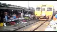 Train Runs Through Bangkok Market