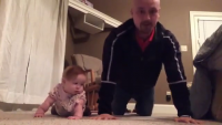 Baby Girl And Father Having Workout Together