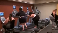 Overweight Woman Tries To Get On Treadmill