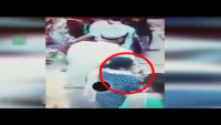 Check How Woman Steals Purse From Man's Pocket In Market