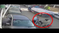 CCTV Footage Of Snatching Valuables In Broad Daylight From A Car Owner In Karachi