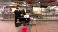 Child playing piano union square