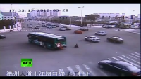 CCTV 3-yr-old on Toy Bike Survives Heavy Traffic in China