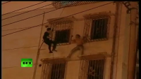 Dramatic Video Cop Swings to Save Suicidal Man in China